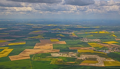 Green & Yellow French Fields (Andy.Gocher) Tags: andygocher canon100d sigma18250 europe france paris cdg windowseat aeroplaneseat aeroplanewindow aerial clouds sky landscape flying