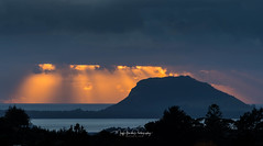 Fizzler... (muzzpix-nz) Tags: sunrise mountmaunganui golden clouds drama storm newzealand silhouette stormy