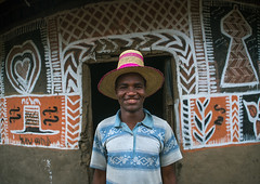 Ethiopian man with a hat standing in front of his traditional painted house, Kembata, Alaba Kuito, Ethiopia (Eric Lafforgue) Tags: abyssinia adult africa alaba architecture art artwork building cheerful color culture decorated decoration depiction eastafrica ethiopia ethnic geometric halaba horizontal hornofafrica house housing hut illustration islam kulito lookingatcamera man mural muslim onemanonly oneperson outdoors painted painting portrait poverty residential ruralscene smile smiling toukoul traditional tukul village waistup ethio163450 alabakuito kembata