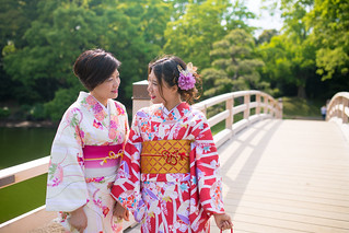 Mother and daughter in kimono looking at each other