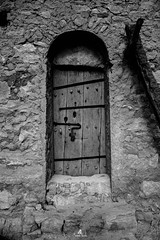 The door of an old berber house (sanaturki) Tags: door details ancient old monochrome blackandwhite stones steps history nikon nikond5300 tunisia tunisie southoftunisia