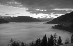 Smoke in the valley, clouds in the sky (PeterThoeny) Tags: schuders graubünden grisons prättigau switzerland alps swissalps sky day sunset dusk fog seaoffog cloudy cloud clouds outdoor landscape mountain serene monochrome blackandwhite 3xp raw nex6 photomatix selp1650 hdr qualityhdr qualityhdrphotography fav200