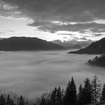 Smoke in the valley, clouds in the sky thumbnail