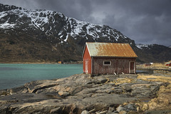 Old boathouse (Sizun Eye) Tags: boathouse skjelfjorden kvalvik flakstodoya island fjord lofoten archipelago nordland norway europe scandinavia hut rocks mountains snow overcast clouds sunlight sizuneye nikond750 d750 tamron2470mmf28 tamron landscape gettyimages