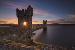 The Tower of the Sun... (fearghal breathnach) Tags: lightinthetower roundwood vartry vartryreservoir wicklow sunset sunflare longexposure calm clouds tower haidafilters leefilters bigstopper towerofthesun