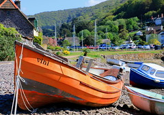 The Orange Boat (acwills2014) Tags: orange colourful vini lavinia beached pebbles somerset westcountry shoreline seascape beach