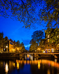 The Herengracht and Leliegracht canals at dusk (Amsterdam, Netherlands 2015) (Alex Stoen) Tags: alexstoenphotography amsterdam architecture bridgebuiltstructure buildingexterior builtstructure canal canals canoneos1dx capitalcities colourimage dusk ef1635f28liiusm herengracht holland illuminated incidentalpeople lensflare longexposure netherlands night onthemove outdoors reflection sky streetlight streetphotography tourist travel traveldestinations tree vertical walking connection motion photography