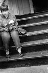 h14-68 12 (ndpa / s. lundeen, archivist) Tags: nick dewolf nickdewolf bw blackwhite photographbynickdewolf film monochrome blackandwhite city summer 1968 1960s 35mm boston massachusetts candid streetphotography citylife streetlife people beaconhill youngpeople steps stairs stairway seated sitting book reading rosemarysbaby woman youngwoman girl denim jeans cutoffs purse handbag brunette shorthair