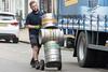Man With Important Job... (Mel Low) Tags: drayman worker streetscene beer barrels candid southwold suffolkcoast nikon nikond7200