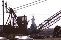 """The Statue of Liberty surrounded by rusting cranes, a pile of discarded tires, abandoned cars and a deserted Central Railroad of NJ train yard tower. The view from the end of Warren Street. A frame from my Super8 film """"Visions"""". Jersey City. April 1976 (wavz13) Tags: oldphotographs oldphotos 1970sphotographs 1970sphotos oldphotography 1970sphotography vintagephotographs vintagephotos vintagephotography filmphotos filmphotography newyorkphotographs newyorkphotos oldnewyorkphotography oldnewyorkphotos vintagenewyork railroadphotos railroadphotography railroads vintagerailroads vintagerailroadphotography oldrailroads oldrailroadphotography depressing bleak noir noire dark oldbuildings vintagebuildings abandonedbuildings jerseycityphotographs jerseycityphotos oldjerseycityphotography oldjerseycityphotos oldjerseycity vintagejerseycity vintagejerseycityphotography jerseycityhistory urbanphotography urbanphotos urbanscenes cityphotography newjerseyphotographs newjerseyphotos oldnewjersey vintagenewjersey newjerseyhistory industrialjerseycity industrialruins industrialwasteland urbanwasteland urbandecay urbanblight"""
