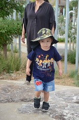 Liam walking through the sandy water-play area (avlxyz) Tags: liam legonexoknights lego nexokights tshirt booranreserve cityofgleneira glenhuntly fb4