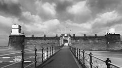 a fortress without a foe - HFF! (lunaryuna) Tags: england wirralpeninsula fortperchrock newbrighton perchrock coast historicarchitecture fortress access fence fencedfriday blackwhite bw monochrome lunaryuna