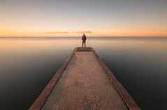 at the end (Marc McDermott) Tags: sunrise water lakeontario canada man person marcmcdermott toronto calm longexposure 10stop neutraldensity horizon sky clouds beautiful wideangle shadow morning tranquil serene