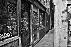 """Masks & Souvenir"" (Venice) (giannipaoloziliani) Tags: hdr forte dark strange darkness strong hard blackandwhite monochrome italia biancoenero monocromatico venice venezia shop masks maschere negozio street streetphotography walls graffiti muri scritte scrittesuimuri written sale details streetphoto centre city downtown flickr nikon nikonphotography nikond3200"