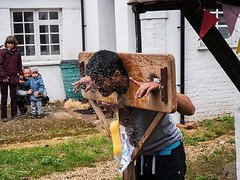 May Day Stocks for Charity (fstop186) Tags: charity stocks wet sponges villagestocks medieval water splash brave young man mayday