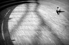 Contemplation (joephoto uk) Tags: scoop city hall london man seated curves shadows