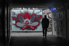 Graffiti tunnel (Daz Smith) Tags: dazsmith fujixt20 fuji xt20 andwhite bath city streetphotography people candid portrait citylife thecity urban streets uk monochrome blancoynegro blackandwhite mono bristol bearpit graffiti silhouette man male walking mural spray