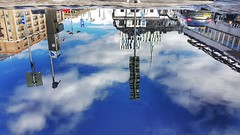 Painting the sky on water. (ileron19) Tags: water reflection concrete light stockholm sweden sky clouds city cielo città acqua riflessi riflesso cemento luce nubi nuvole stoccolma svezia samsung s7 upsidedown capovolto