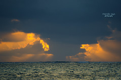 behind the clouds ... (mariola aga) Tags: puntacana dominicanrepublic atlanticocean ocean water waves morning sunrise clouds sunlight glow nature thegalaxy