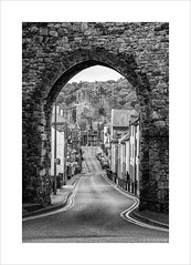 Sign o' the Times (andyrousephotography) Tags: conwy castle wales edwardi town seaside harbour highstreet castlest trafficfree tourists visitors costa coffee bw blackandwhite conversion sadness memories childhood andyrouse eos 5d mkiii 24105mmf4