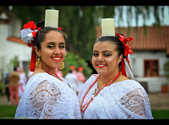 Balancing Act at the Ballet Folklorico Competition in Old Town San Diego - Cinco de Mayo 2017 (Sam Antonio Photography) Tags: cincodemayo oldtown sandiego california latin holiday mexicana hispanic festive fiesta mexico girl female smile ethnic mexican cheerful candle twowomen editorial party celebration decoration 5thmay samantoniophotography portrait environmentalportrait balance mexicanculture spanish smiling