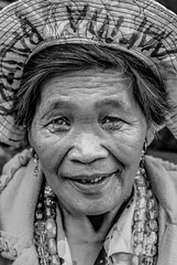 Ibaloi Tribe Woman #2 (FotoGrazio) Tags: asian filipina filipino ibaloi pacificislander philippines pinay streetphotography waynegrazio waynesgrazio woman artofphotography composition existinglightportrait eyes face fotograzio indigenous indigenouspeople native people portrait portraiture smile streetportrait tribe