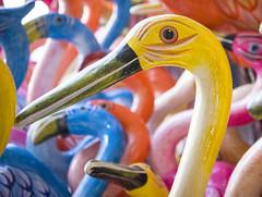 Flamingo factory (Mark Chandler Photography) Tags: 7dmarkii freedomoftheseas markchandler royalcaribbean vacation beach canon caribbean cozumel cruise holiday mexico ocean sand sea ship sun tourism gulfofmexico color colour colourful colorful bird gifts bokeh yellow orange blue flamingo tourist