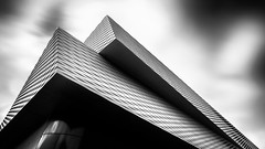 Implant (Robert_Franz) Tags: architecture architectural longexposure urban city basel blackwhite design swiss messe detail facade wideangle sky clowds