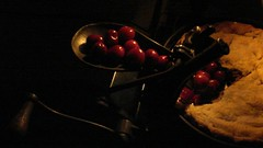 Cherry Pitting (Rand Luv'n Life) Tags: odc our daily challenge homemade cherry pie antique pitter low amber lighting nest nesting kitchen cooking baking black background indoor composition food dessert light pastry crust