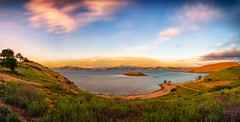 Windy Morning Panorama (stuanderson7) Tags: grass filter sunrise nature dawn mountains outdoor lake clouds vibrant morning trees sonya6000 shore water wind blown countryside california sky green reservoir landscape hills samyang12mmf2 ndfilter longexposure windblown