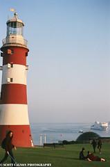Plymouth Hoe [35mm film] (scott calnon) Tags: film hoe filmisnotdead grain swisbest 35mmfilm warmth nikonf5 35mm 135film grainnotmegapixel goldenhour ocean sea seascape portrait ship ferry lighthouse