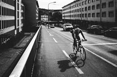 despair and traffic (matthias hämmerly) Tags: switzerland candid street streetphotography shadow contrast grain ricoh gr black white bw monochrom monochrome city town urban blackandwhite strasse people man monochromphotography dark zürich zuerich bicycle velo cycle cycling sun