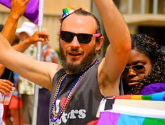 Man with weird sunglasses (LarryJay99 ) Tags: beads pridefest dude gay goatee colorful lakeworth sunglasses facialhair ramps virile roosters peekingpits gayman handsome rainbow florida sexyman prideparade arms face glasses mustache beard people canonefs18135mmf3556is