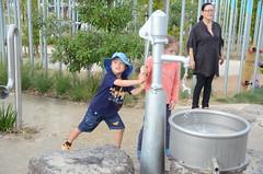 Isaac pumping water at the water-play area (avlxyz) Tags: isaac legonexoknights lego nexokights tshirt booranreserve cityofgleneira glenhuntly fb4