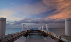 Abandoned pier long exposure (Krevo55) Tags: turksandcaicos caribbean paradise ocean sea water sand beach tropical providenciales islands seashore waves sun clouds sky nature outdoor landscape provo pier abandoned gracebay sunset longexposure