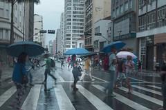 Moving (mara.arantes) Tags: street city rain people moving building rua pessoas chuva cidade movimento long exposure