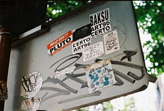 PLUTO (35mm) (jcbkk1956) Tags: sign stickers graffiti street bangkok thailand thonglo film 35mm nikon fm2n analog kodak kodakgold200 manualfocus pluto nikkor 50mmf18 worldtrekker