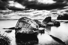 Forces of Nature (Dan Constien) Tags: longexposure weldingglass sonya7 madisonwisconsin rocks water clouds blackandwhite monochrome lakemendota