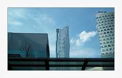 Three buildings, and one tree, and blue sky with white cloud (mariuszj8) Tags: warsaw poland