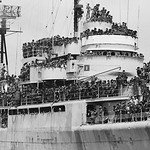 Fall of Saigon - 01 Apr 1975, Cam Ranh - Loaded from bow to stern with South Vietnamese Marines, the U.S. ship  pulls into dock thumbnail