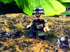 Jungle Wehrmacht soldier (Brick Operator) Tags: wet lushjungle wehrmacht ww2 wwii german soldier nazi lego brick brickarms arms slick bricks rain forest nature