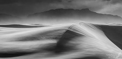 Blowing (Squirrel Girl cbk) Tags: 2017 april newmexico whitesandsnationalmonument wind blustery blowingsand storm gritty monotone bw monochrome dunes windy explore