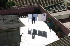 Strong shadows (Micheo) Tags: spain sol sunshine luces sombras ropa clothes hanging colada terraza