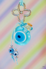 Macro Monday ~ Eye(s) (Jan Whybourne) Tags: macromonday eyes evil necklace talisman blue pastel diagonal beads charms glass bottle