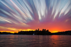 Torn Sky (Matt Molloy) Tags: mattmolloy timelapse photography timestack photostack movement motion colourful sky sunset clouds trails lines rips red glow ice lake reflection trees littlecranberrylake seeleysbay ontario canada landscape nature lovelife