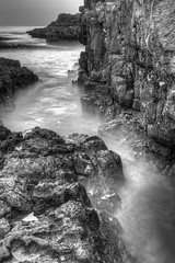Permanently Lonely (pauldunn52) Tags: long exposure ogmore by sea deeps rocks cliffs water black white