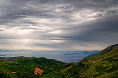 Mediteranian Approaching Rain (Alfred Grupstra) Tags: nature mountain landscape cloudsky scenics hill outdoors sky forest summer cloudscape greencolor beautyinnature valley blue tree mountainrange grass ruralscene travel corfu mediteranian greece