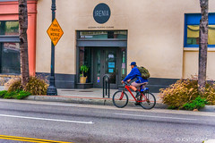 Irenia's (www.karltonhuberphotography.com) Tags: 2017 bicycle bicyclist citystreets hdr irenia karltonhuber man outdoors peoplewatching restaurant santaana sidewalk signs southencalifornia storefronts streetphotography streetscene theoc urban
