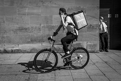 The Delivery (Leanne Boulton) Tags: monochrome bike people urban street candid portrait streetphotography candidstreetphotography streetlife man men male face faces expression mobile phone bicycle cycle cycling riding delivery deliveroo juxtaposition storytelling story doorway tone texture detail depth naturallight sunlight outdoor light shade shadow shadows city scene human life living humanity society culture work canon canon5d 5dmarkiii 35mm wideangle ef2470mmf28liiusm black white blackwhite bw mono blackandwhite glasgow scotland uk