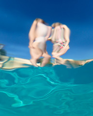 Zara and Amber from underwater (Kevin Roche) Tags: italy lakegarda swimingpool